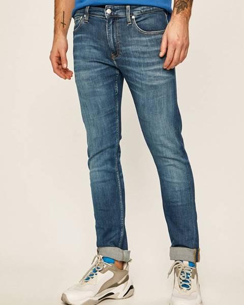 Tmavomodré rifle Calvin Klein Jeans