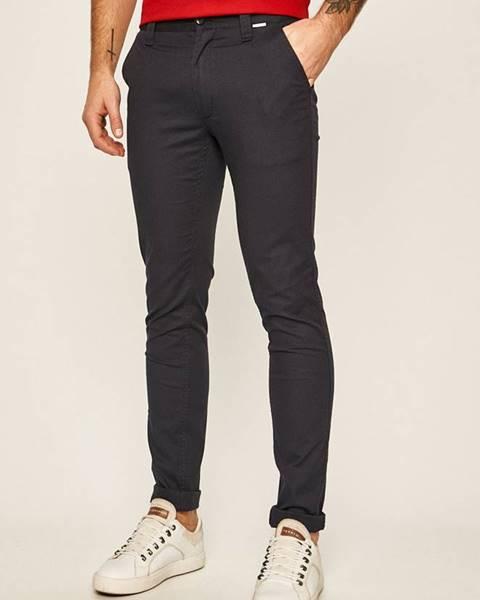 Tmavomodré nohavice Calvin Klein